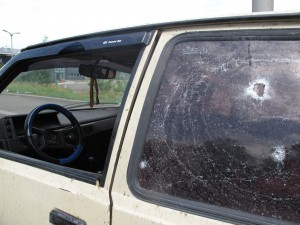 hatchback: A passenger vehicle bearing an orange and black St. George's Ribbon - the symbol used by Ukraine's separatists - lies riddled with bullet holes near the entrance to Donetsk's international airport. (Jacob Resneck/FSRN)