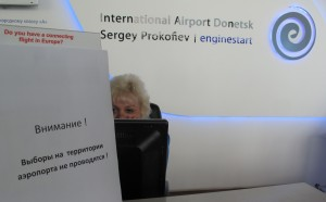 yes there is no voting: A posted notice at the Information Desk states that voting had been canceled at the central government-controlled Donetsk International Airport. (Jacob Resneck/FSRN)