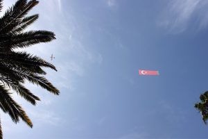 "A plane spotted overhead during the Armenian Genocide Remembrance Day rally flew Turkish flags and banners calling the Armenians ""liars."" (Photo credit: Lena Nozizwe)"