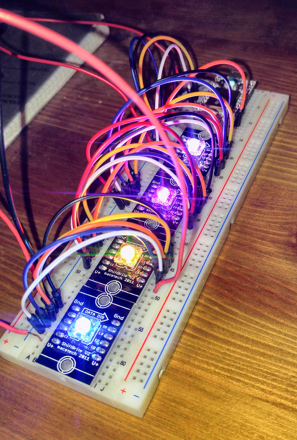 Breadboard chain of ShiftBrites powered by a Particle Core