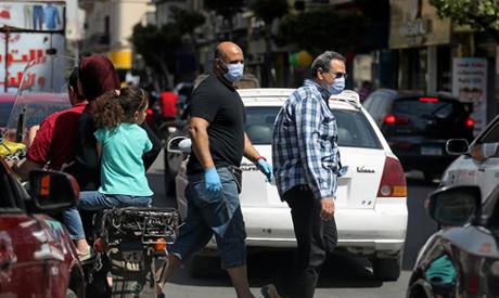 مصر تسجل 878 إصابة جديدة بفيروس كورونا و 55 حالة وفاة الاثنين - سياسة - مصر